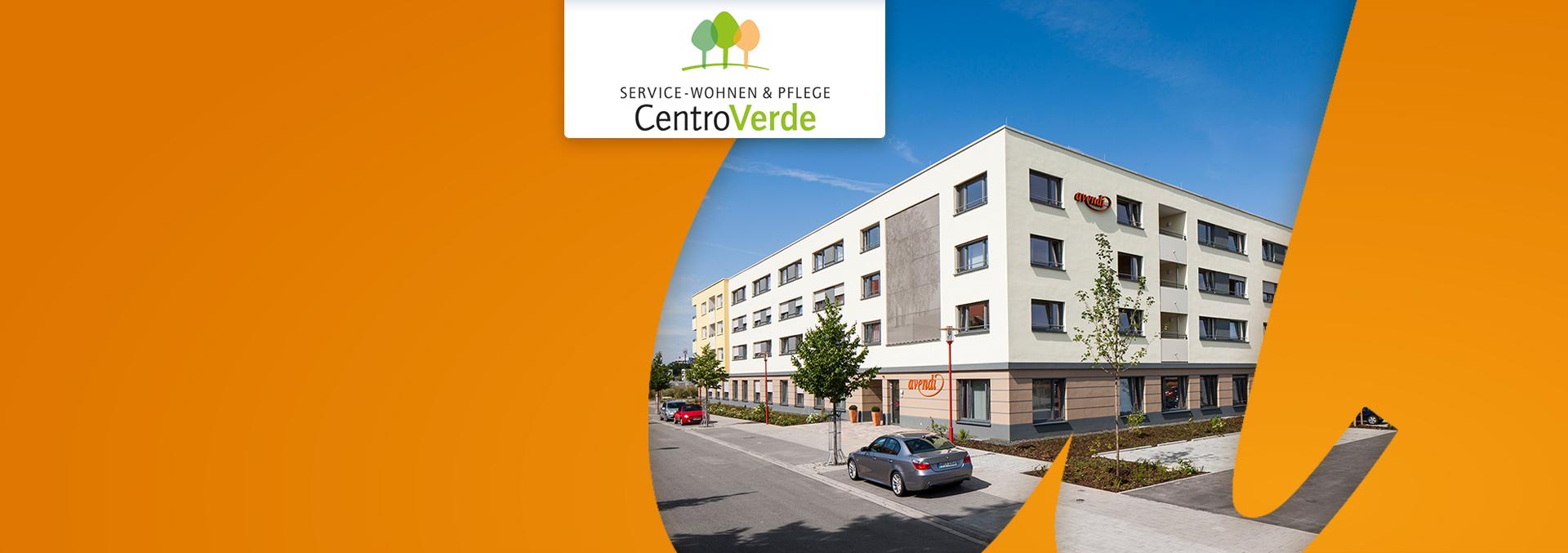 Service-Wohnen und Pflege CentroVerde: Außenansicht mit Blick auf den Eingang, vierstöckiges Gebäude, großzügige Parkflächen