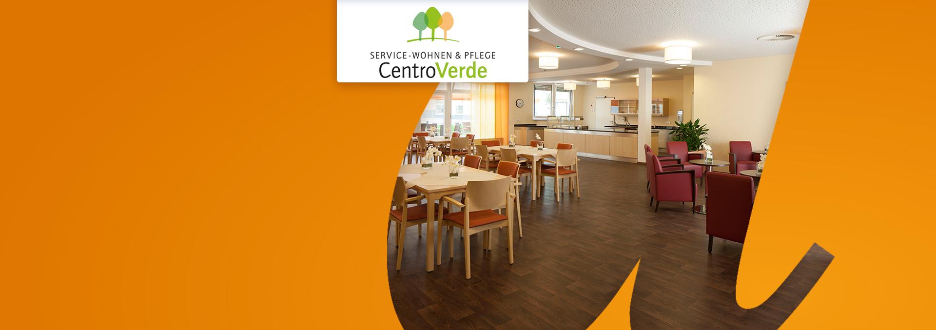 Service-Wohnen und Pflege CentroVerde: Cafeteria, dunkles Parkett, helle Wände und Sitzmöbel, rote Sessel.