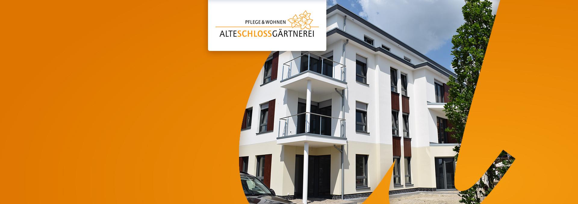Pflege und Wohnen Alte Schlossgärtnerei, Blick von außen auf die Ecke des vierstöckigen Hauses mit Balkonen.